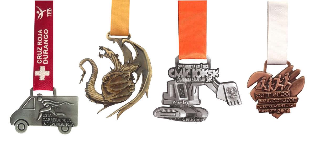 imagen de medallas con formas especiales. Medalla con forma de camíon, de dragón, de trascabo y de corazón