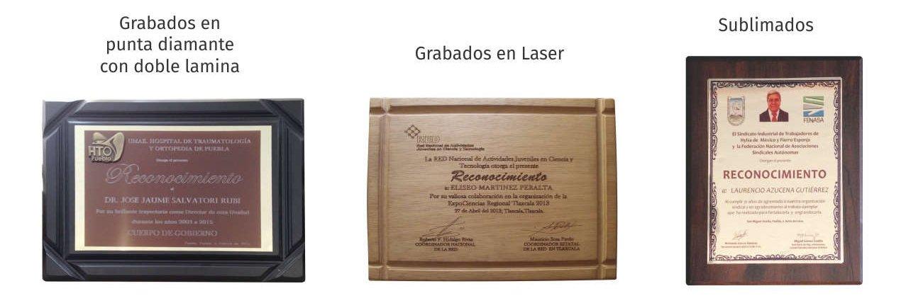 Imagen con 3 reconocimientos, con bases de madera con placa grabada con diamante, grabado en láser y placa sublimada